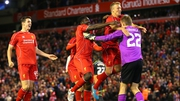 Liverpool players celebrate after Albert Adomah's miss