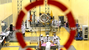 Scientists and engineers work on a Mars Orbiter vehicle at the Indian Space Research Organisation's  satellite centre in Bangalore