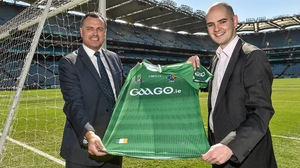 Ireland  manager Paul Earley (l) and Noel Quinn, media rights manager with the GAA pictured with the new jersey