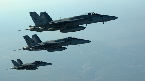 US Navy F-18E Super Hornets leaving after receiving fuel from Stratotanker over northern Iraq