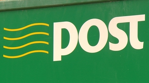 An Post saw revenues rise after an increase in postal rates and better income from ancillary services