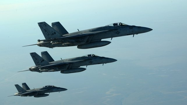 A formation of US Navy F18E Super Hornets, which have taken part in air strikes against Islamic State