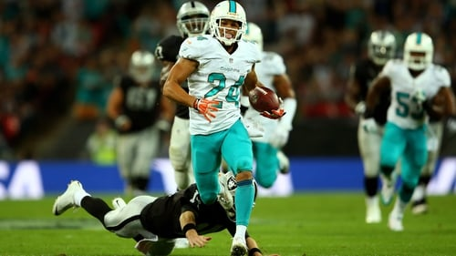 Cortland Finnegan of the Miami Dolphins returns a fumble to score a touchdown