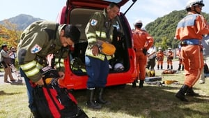 Rescue workers put their gear away as rescue operations on Mount Ontake are halted for the day