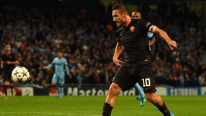 Francesco Totti prods home Roma's equaliser
