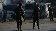 Afghan security personnel at the site of the bomb attack on the army bus in Kabul