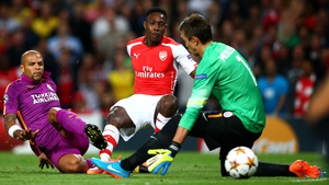Arsenal's Danny Welbeck scores the opening goal past Galatasaray 'keeper Fernando Muslera