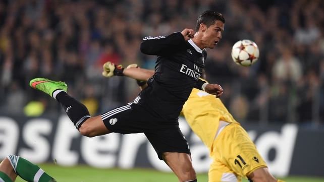 Real Madrid's Portuguese forward Cristiano Ronaldo and Ludogorets' goalkeeper Vladislav Stoyanov