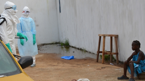 A child cries outside a clinic in the Sierra Leone capital after the deaths of her parents from Ebola