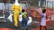 Two children infected with Ebola follow a medical worker in the high-risk area of the Elwa hospital run by MSF in Monrovia