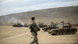 Turkish army tanks take position near the Syrian border last week