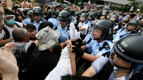 Scuffles break out between pro-democracy protesters and police in central Hong Kong