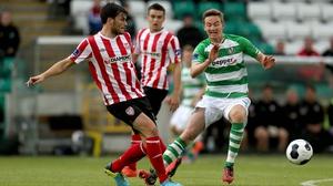 Shamrock Rovers Ronan Finn closes down Phillip Lowry of Derry City