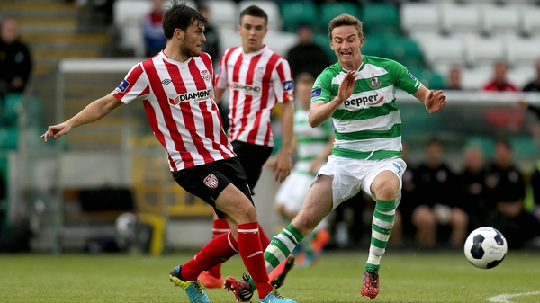 Shamrock Rovers Ronan Finn closes down Phillip Lowry of Derry City