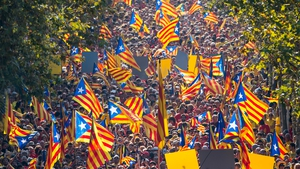 Demonstrators wave Catalan flags during an independence demonstration