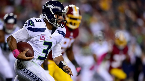 Quarterback Russell Wilson of the Seattle Seahawks rushes during the first half of the win over Washington Redskins