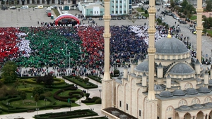 Some of the 100,000 marchers celebrating Vladimir Putin's 62nd birthday in Chechen capital Grozny