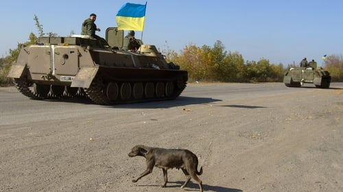 A Ukrainian armored personnel carrier patrols along a road leading to the town of Debaltseve in the Donetsk region