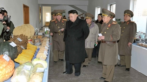 North Korean leader Kim Jong-un (C) inspecting the command of Korean People's Army
