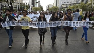 Protesters march during a demonstration in Mexico City