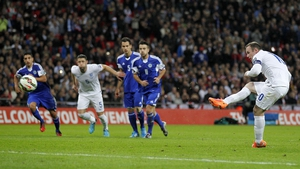 Wayne Rooney scores from a penalty to give England their second goal