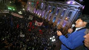 Evo Morales (R) celebrates his victory at the Government Palace in La Paz, Bolivia