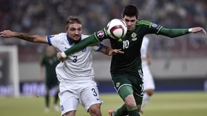 Northern Ireland's Kyle Lafferty (right) vies for the ball with Greece's Kostas Stafylidis