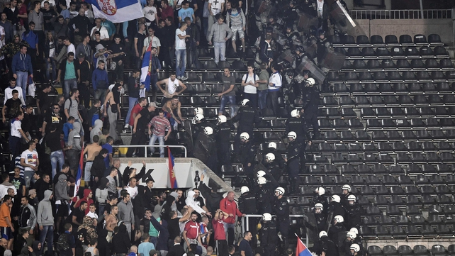 Riot police clash with Serbian fans