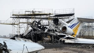 The carcasses of a destroyed aeroplane is seen on the tarmac at Donetsk's Sergey Prokofiev international airport