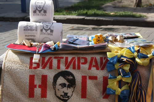 Street stall in Kiev selling toilet paper with Vladimir Putin's image.  Also, Putin represented as Hitler.