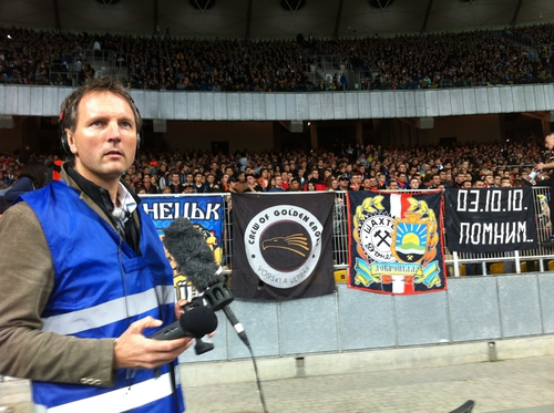 Tony Connelly at Olympic Stadium, Kiev.  In the background, FC Shakhtar Donetsk Ultras