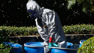 A hazmat worker removes a barrel from the apartment where US nurse Amber Vinson lives