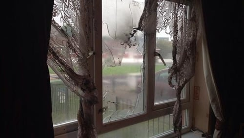 The petrol bomb was thrown through the front window of the house
