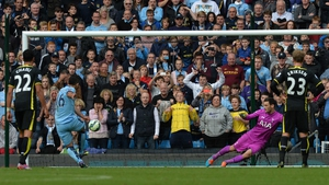 Sergio Aguero smashes home his third, from the penalty spot