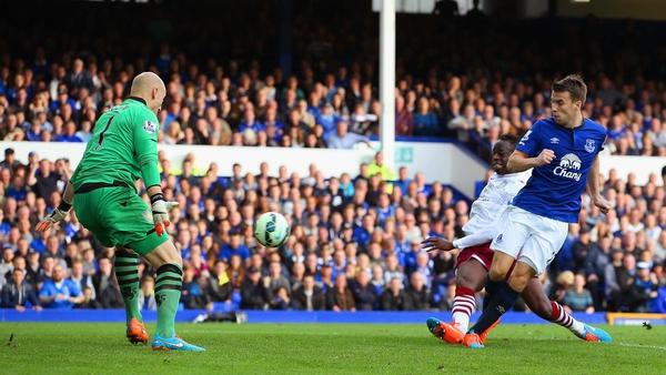 Seamus Coleman prods home Everton's third