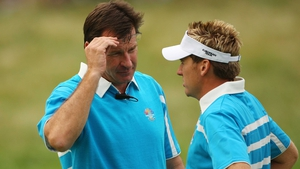 Ian Poulter speaks with then captain Nick Faldo on day two of the 2008 Ryder Cup