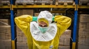 An employee of a factory tries on special Ebola gear in Berkel en Rodenrijs, The Netherlands