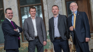 DisplayNote's management team with representatives of Bank of Ireland and Kernel Capital