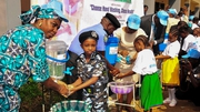 The Nigerian Minister of Water Resources washes hands with school children as part of an Ebola campaign