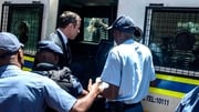 Oscar Pistorius is led away to Pretoria's Kgosi Mampuru prison