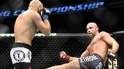 Cathal Pendred swings a kick in the direction of Gasan Umalatov