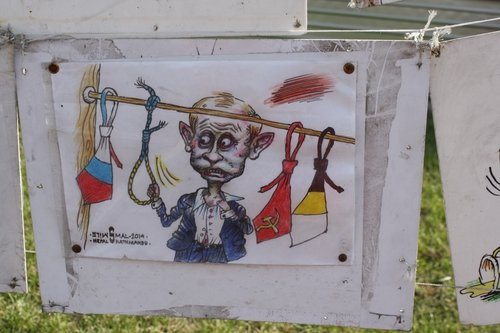Political cartoons on display on a Kiev street