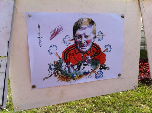 Rinat Akhmetov depicted in a political cartoon displayed on a Kiev street