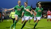 Cork City players celebrate the stunning Colin Healy (L) overhead kick that delivered a vital win over St Pat's