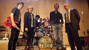 Minister Humphreys on the Sing Street set with director John Carney, star Ferdia Walsh-Peelo and Bord Scannán na hÉireann/Irish Film Board Chief Executive James Hickey