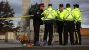 "Police said the man was arrested for ""disturbing the crime scene"" at the war memorial"
