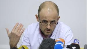 Neurosurgeon professor Jean-Francois Payen speaks during a press conference
