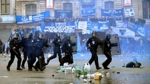 French riot police run on the Grand Place, the main square of Lille, where Everton's supporters have gathered