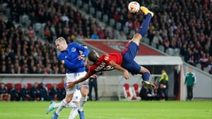 Lille's Ronny Rodelin attempts the spectacular with Tony Hibbert challenging