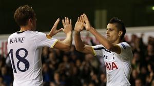 Tottenham goalscorers Erik Lamela (R) and Harry Kane congratulate each other